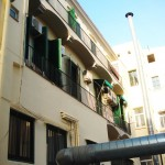 restauració de façana posterior d'edifici plurifamiliar