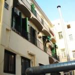 restauracion de fachada posterior de edificio plurifamiliar